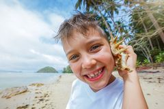 Boy playing at the beach. Stock Photo