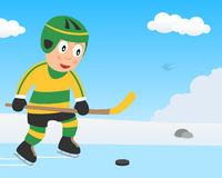 Cute Boy Playing Hockey on Ice in the Park Stock Images