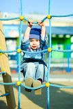 Cute boy playing outddor Royalty Free Stock Images