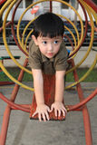 Cute boy playing at playground Stock Image