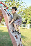 Cute boy playing at playground Royalty Free Stock Image