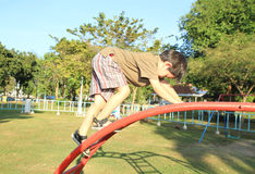Cute boy playing at playground Royalty Free Stock Images