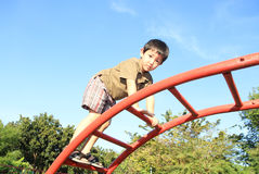 Cute boy playing at playground Stock Images