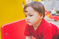 Cute boy playing on playground royalty free stock images