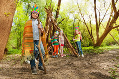 Cute boy playing Red Indian chief in the forest Stock Photo