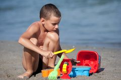 Cute boy playing in sand Royalty Free Stock Photo