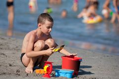 Cute boy playing in sand Stock Photography