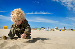 Cute boy playing with sand Stock Photo