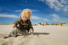 Cute boy playing with sand Stock Photography