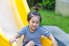Cute boy is playing slider in playground. Stock Images