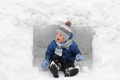 Cute boy playing in the snow Stock Photography