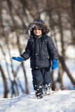 Cute boy playing with snow Royalty Free Stock Photos