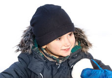 Cute boy playing with snow Royalty Free Stock Photo