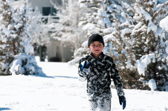 Cute boy playing in the snow. Royalty Free Stock Photo