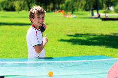 Cute boy playing table tennis Stock Photos