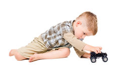 Cute boy playing toy car Royalty Free Stock Photography