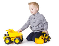 Cute Boy playing with toy trucks Stock Photography