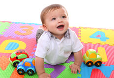 Cute Boy Playing with Toys Royalty Free Stock Image