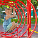 Cute boy playing in tunnel on playground Stock Images