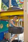 Cute boy playing in tunnel on playground Stock Photography