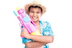 Cute boy playing water gun on white background. Songkran Festival in Thailand and summer season Stock Photos