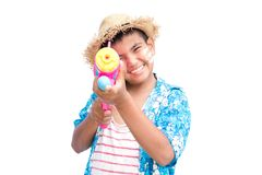 Cute boy playing water gun on white background. Songkran Festival in Thailand and summer season Royalty Free Stock Photography