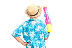 Cute boy playing water gun on white background. Songkran Festival in Thailand and summer season Royalty Free Stock Images