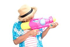 Cute boy playing water gun on white background. Songkran Festival in Thailand and summer season Stock Photo