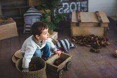 Cute boy plays on a floor in a studio Stock Photos