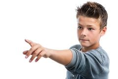 Cute boy pointing into the distance with finger. Close up portrait of cute teen boy pointing with finger into the distance.isolated on white background Royalty Free Stock Images