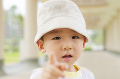 Cute boy pointing finger hand forward Stock Images