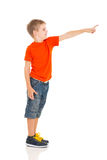 Cute boy pointing. Cute little boy pointing copy space isolated on white background Stock Photo
