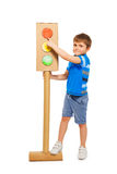 Cute boy pointing to red signal of traffic light Royalty Free Stock Photo