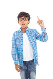 Cute boy pointing up with finger Royalty Free Stock Image