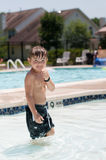 Cute boy in pool. Boy in wading pool looking at camera Stock Images