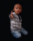 Cute boy portrait. Cute African American boy poses with silly expression royalty free stock photography