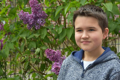 Cute boy. Portrait  of a  boy with charmingly smile outside in the garden Stock Photo
