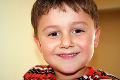 Cute boy portraits. A cute boy portraits while he is smiling stock image