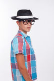 Cute boy is posing with cap and eyewear Stock Photography