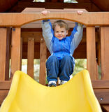 Cute boy preparing to slide. Royalty Free Stock Image
