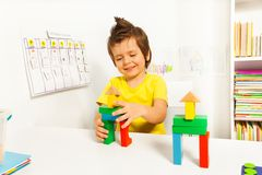 Cute boy putting blocks replicating example Royalty Free Stock Photo