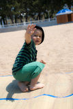 Cute boy with a raised hand in greeting Royalty Free Stock Photos