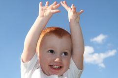Cute boy reaching for sky Royalty Free Stock Photography