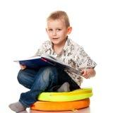 Cute boy reading a book Stock Image