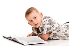 Cute boy reading a book Stock Photos