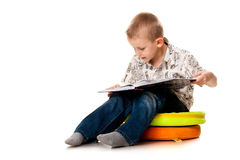 Cute boy reading a book Royalty Free Stock Photography