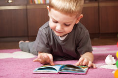 Cute boy reading book Stock Photos