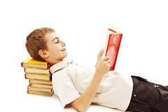 Cute boy reading a book on the floor Royalty Free Stock Photos