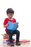 Cute boy reading Royalty Free Stock Photos