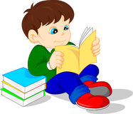Cute boy reading books Royalty Free Stock Photos
